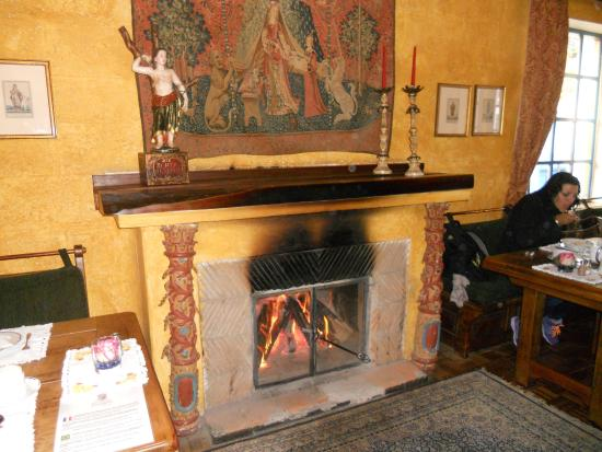 Hacienda Cusin: Fireplace in Dining Room