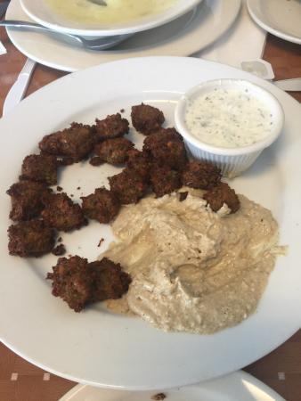 Stoughton, MA: Half-eaten Falafel Appetizer with Hummus and Yoghurt