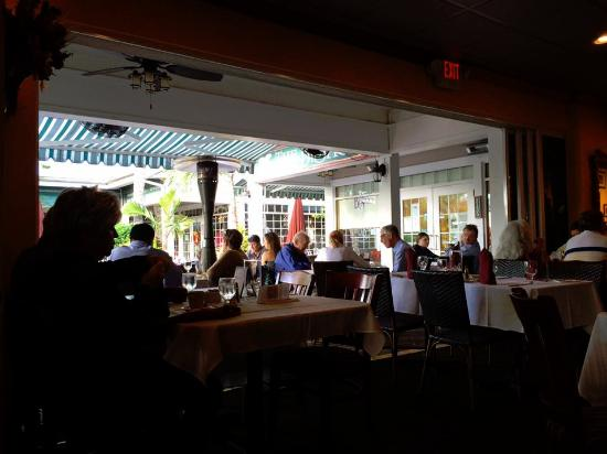 Bistro: Open wall where you can be seated outside or straddle both.
