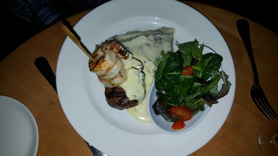 Swansea, MA : Surf and Turf featured three jumbo shrimp, a 6 oz Filet Mignon and a side salad.