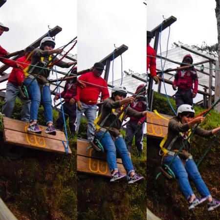 a big metal swing with a harness and helmet