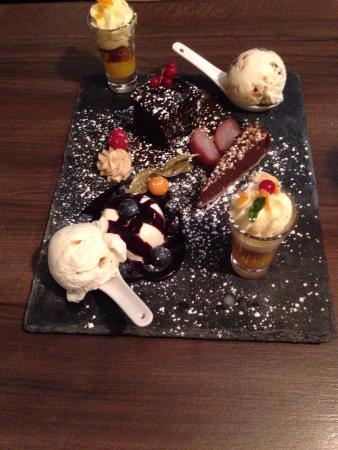 Towcester, UK: Fabulous food. Attentive staff.  The photo doesn't do the sharing dessert justice. Sublime.