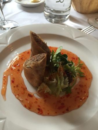 Burley, UK: Duck spring rolls with sweet chilli sauce and freshly diced chilli in the roll.