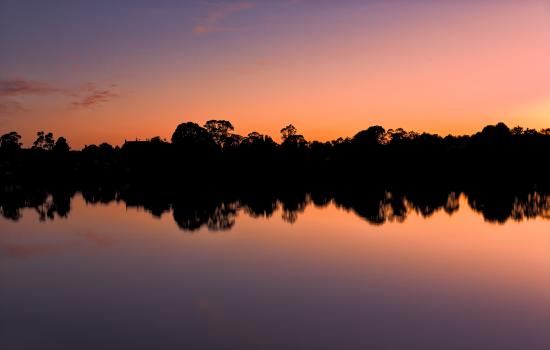 Moruya, Australia: This was the sunset view from our campsite!