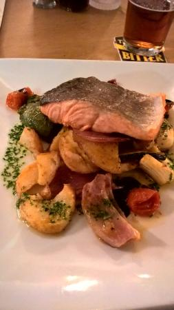 Mold, UK: Char Grilled sea Trout with vegetables and pesto oil