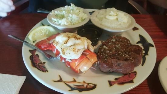Haines City, FL: My meal with a large filet mignon, Maine lobster tail, grits and slaw