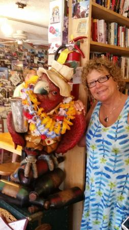 Jensen Beach, FL: A member of the Islander's eclectic collection oversees the lending library