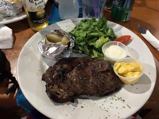 Roy's Restaurant: Rib eye steak with baked potato and caesar salad
