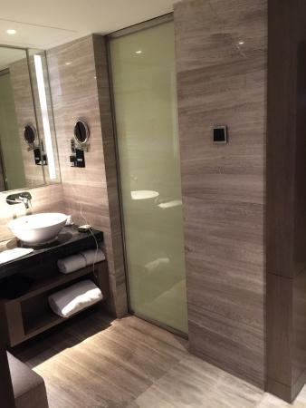 Grand Mercure Shanghai Central: The bathroom is small, modern, and has it all with plenty of light.