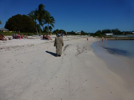 Walking winter clad on a sunny but wind chill induced weather on the SOMBRERO BEACH FL.
