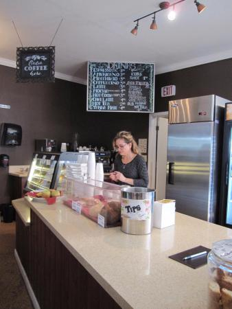 Ben Lomond, CA: The beverage menu and the barista making our coffee