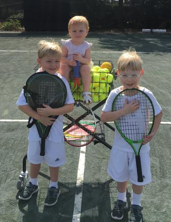 Island Tennis : Tennis anyone? My two sons loved their first tennis lesson--while baby sister watched!