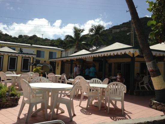Sebastian's on the Beach: Outdoor seating by the restaurant; sitting inside is nice too - open air.