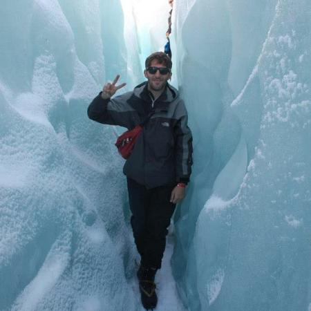 Franz Josef, New Zealand: Squeezing between ice cubes.