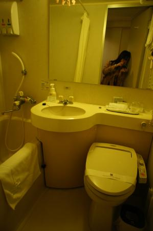 Standard size bathroom that comes with a bathtub and all the essential toiletries.
