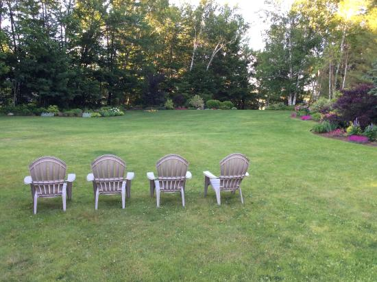 Wilton, ME : These chairs are in search of some company... on the long lawn that stretches down to the Lake.