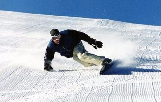 Copper Mountain, CO: High speed toe side euro-turn on fresh corduroy