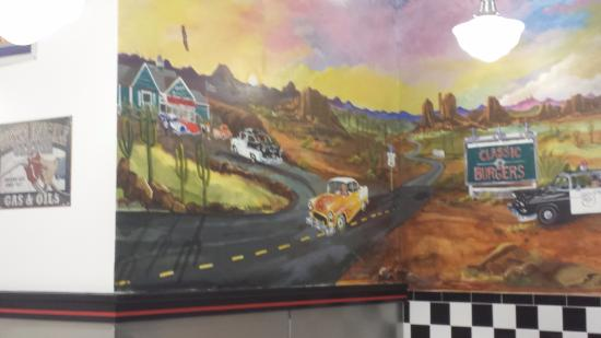 Mural by local artist, Beverly Hosmer, sets the mood at Classic Burgers in West Springfield, MA.