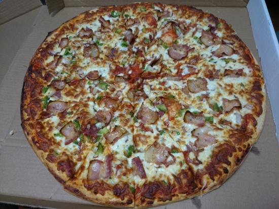 """Cambridge, Canada: Party size (18"""") with: double cheese, pepperoni, sausage, salami, green peppers, onions"""