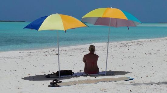 Out Islands: Caroline sitting on Tropic of Cancer beach