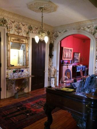 Brownstone Inn Downtown: Much more beautiful in person. Each fixture, painting and price of furniture has a story. Just a