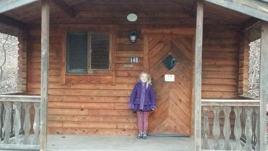 Platte City, MO: Posing in front of a sleeping cabin (we didn't rent one of these).