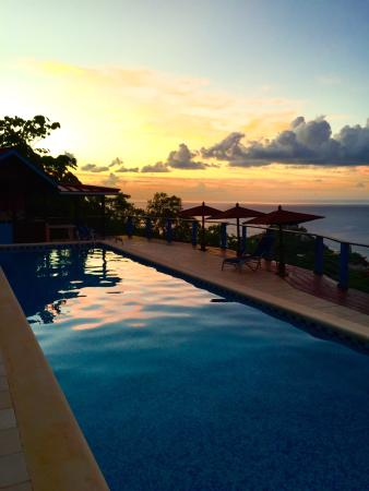 Chateau Mygo Villas: The pool at sunset. A great place to be.