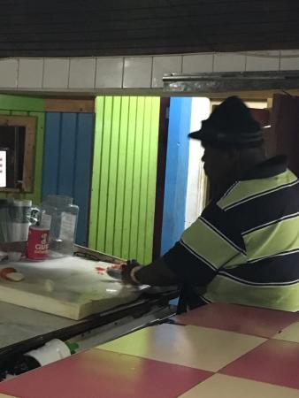 Goldie's Conch House Nassau Bahamas: Big Daddy making his famous Conch Salad.