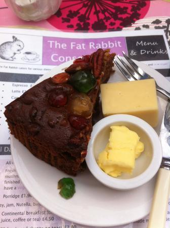 Slab of fruit cake served with strong cheddar cheese and
