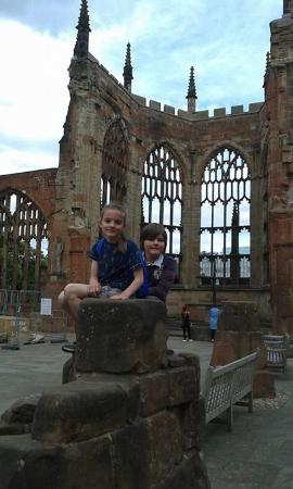 Coventry, UK: My kids sitting on some the cathedral ruins.