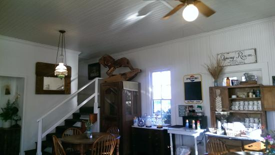 Comfort, TX: charming carved rocking horse. stairs to rooms above.