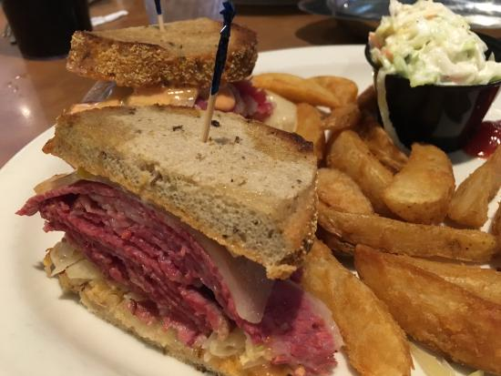 Tempe, AZ: Delicious Ruben with fries and cole slaw.