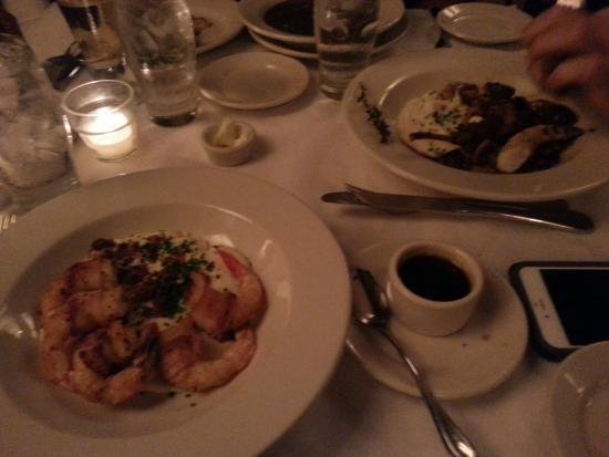 Mr. B's Bistro: Shrimp wrapped in bacon with grits and Braised Rabbit... yum!