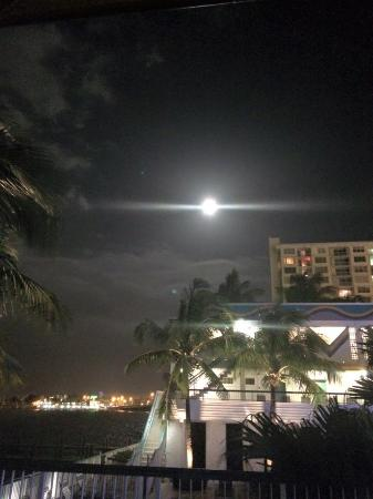 North Bay Village, FL: overlooking the pool area with Miami Beach and full moon in the distance