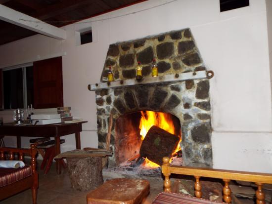 Finca Hartmann : Fireplace in main room.
