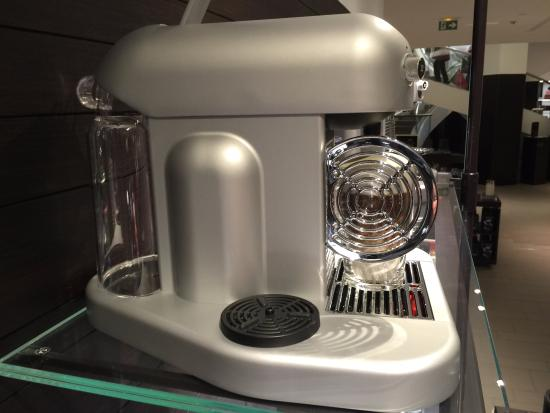 how to put pod in nespresso machine