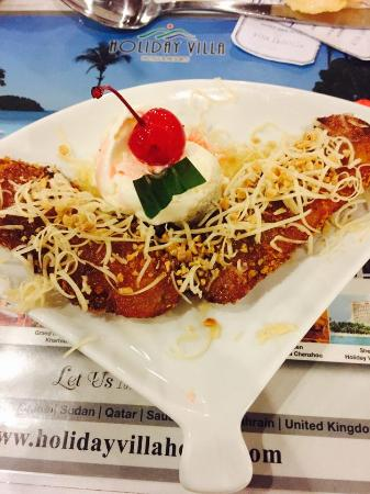 Banana Fritter Ala Mode Topped With Cheese Picture Of Wina Holiday Villa Kuta Bali Kuta Tripadvisor