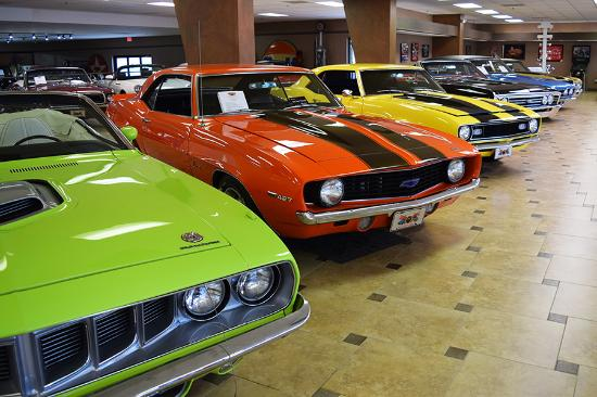 a line of muscle cars from the late 60's- early 70's. - picture of