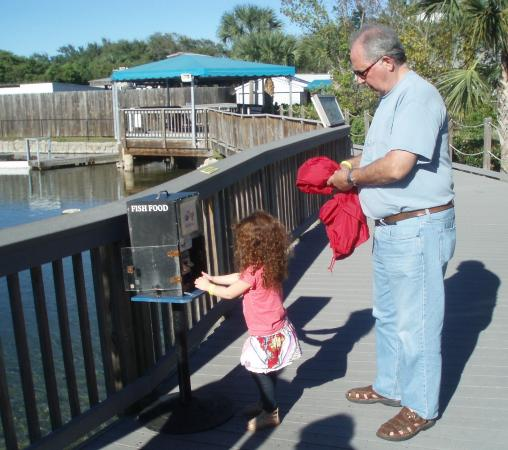 Florida Oceanographic Coastal Center : Grandpa and Daisy buying fish food