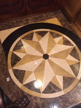 Four Seasons Hotel Houston: Elevator floor.  I am not sure if it's real marble.