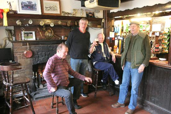 Little Shelford, UK: The owner in a black sweater with other patrons posing for a picture where the stand, or sit.