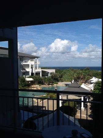 Kingscliff, Australia: View from living area across balcony to pool and ocean