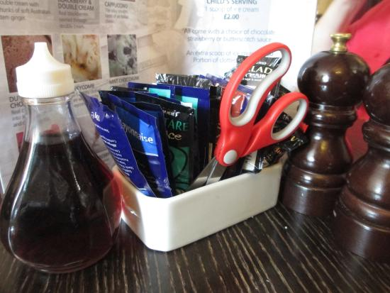Wheddon Cross, UK: How cool! Scissors to open those blasted packets of condiments.