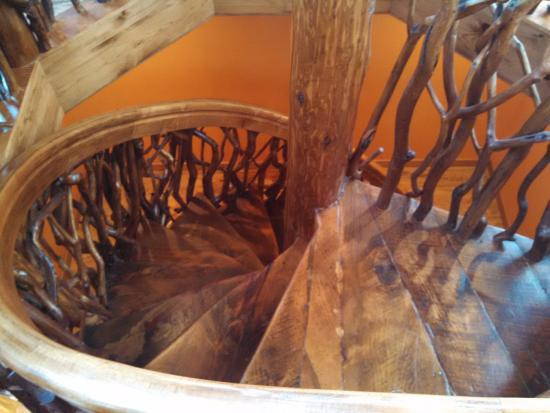 Bellaire, MI: The spiral staircase to the cupola made from wood mostly found on the property.