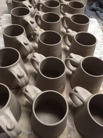 New Smyrna Beach, FL: A board of mugs waiting to dry
