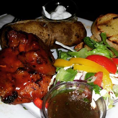 Falmouth, Antigua: BBQ Pork   Baked Potato   Garlic Bread   Salad.... This was amazing! Zambuka pops up only every