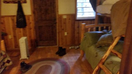 Prospect, Oregon: front of cabin featured 1 queen bed with twin bunkbed on top and an additional twin bed
