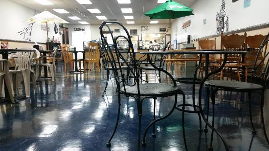 Hoquiam, WA: Inside tables and chairs are an eclectic mix, but they work
