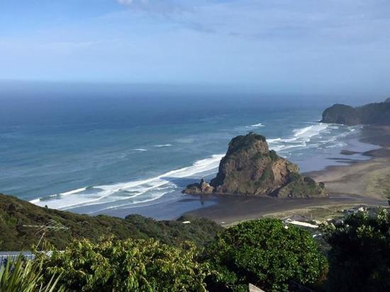 Looking down to Piha Beach and Lion`s Rock
