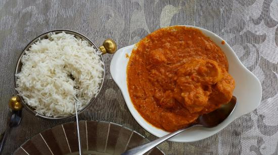Geet Indian Restaurant : Aangara Alu-Fusion with chicken and mashed potatoes colour yellow, served with basmati rice